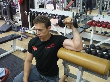 Rotation externe debout • Musculation des deltoïdes